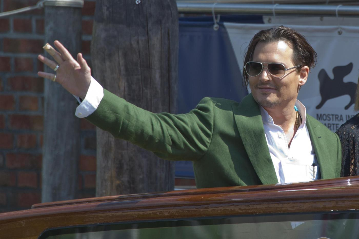 Johnny Depp e Dakota Johnson al Festival di Venezia 2015 per l'anteprima di Black Mass