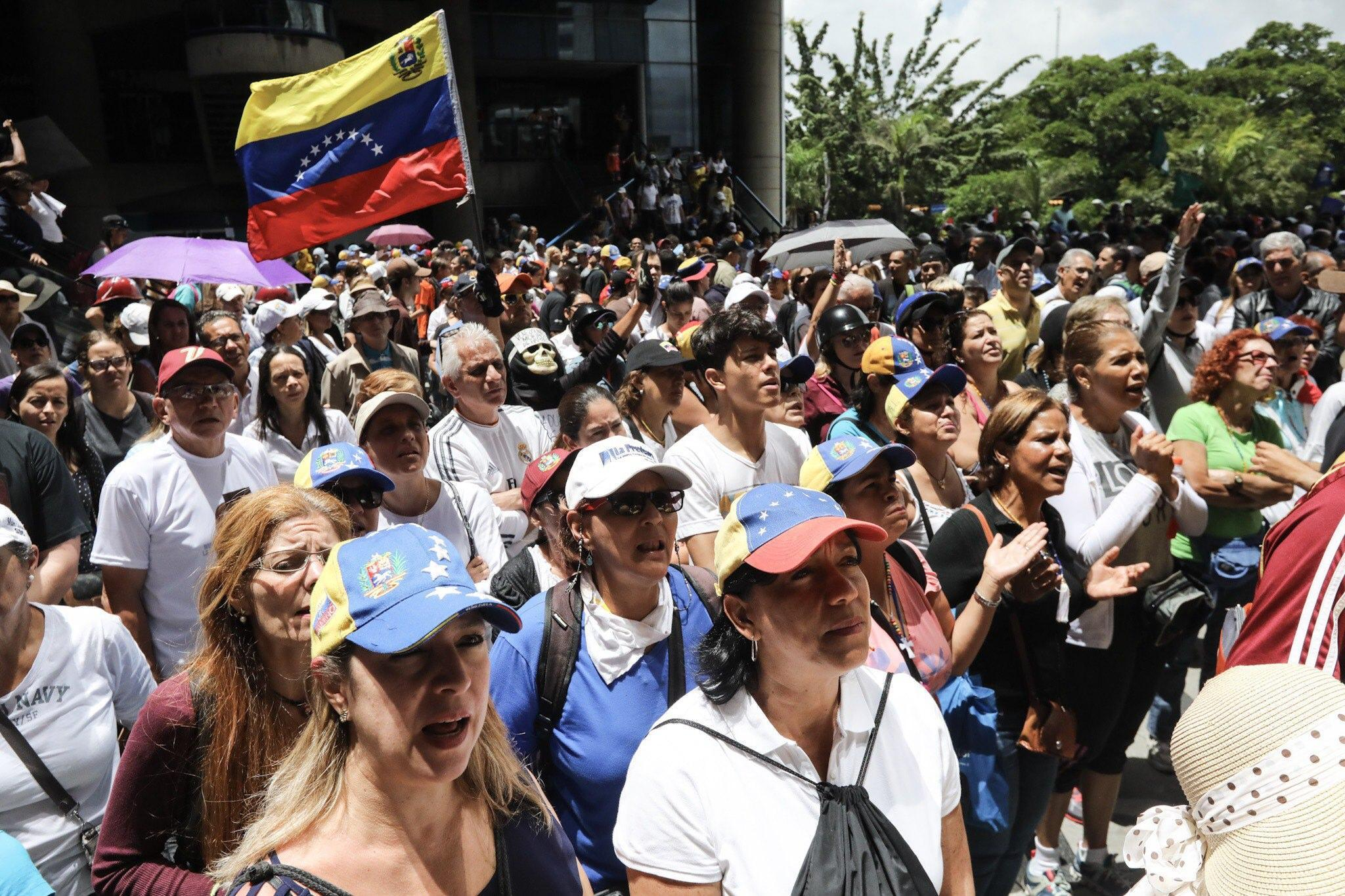 Opposition protesters march in Caracas despite restrictions