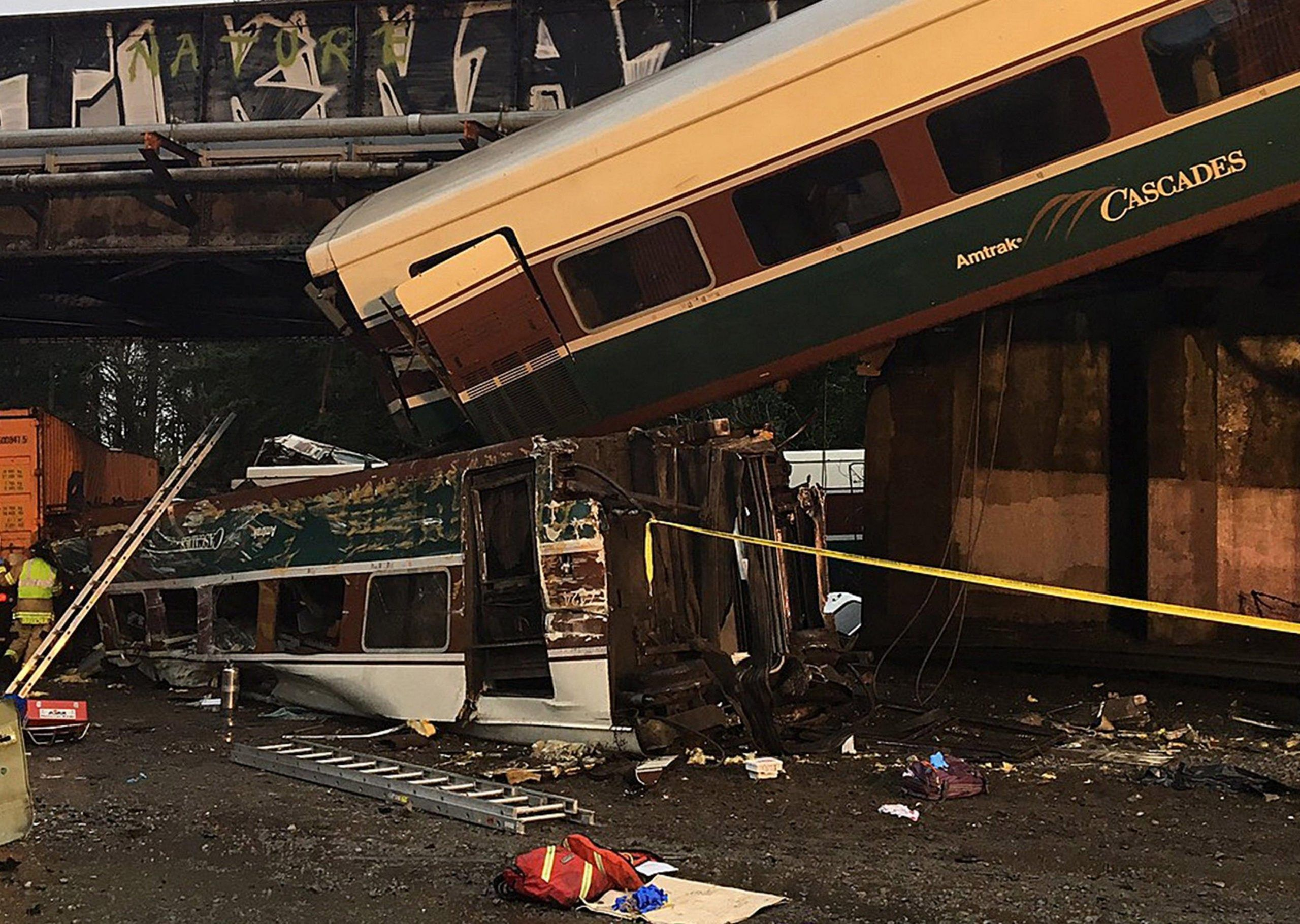 Amtrak train derails over highway