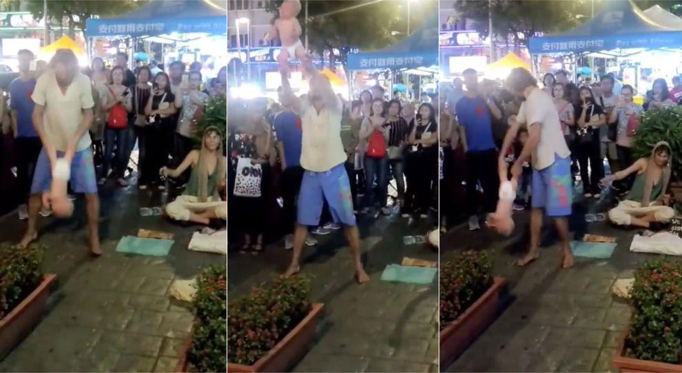Lanciano in aria la figlia di 4 mesi per lo show acrobatico: coppia arrestata in Malesia